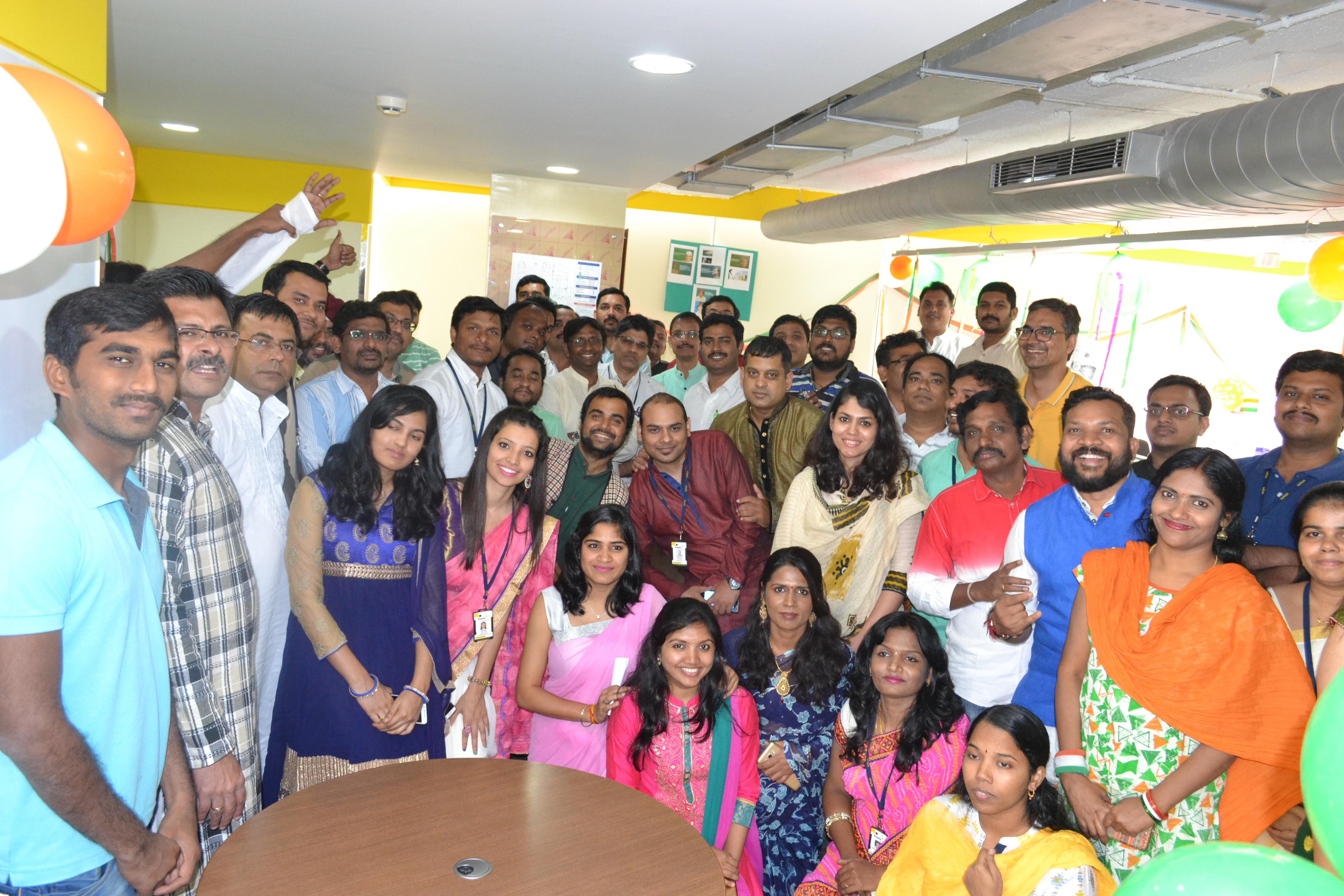 Big group shot in office celebration.jpg