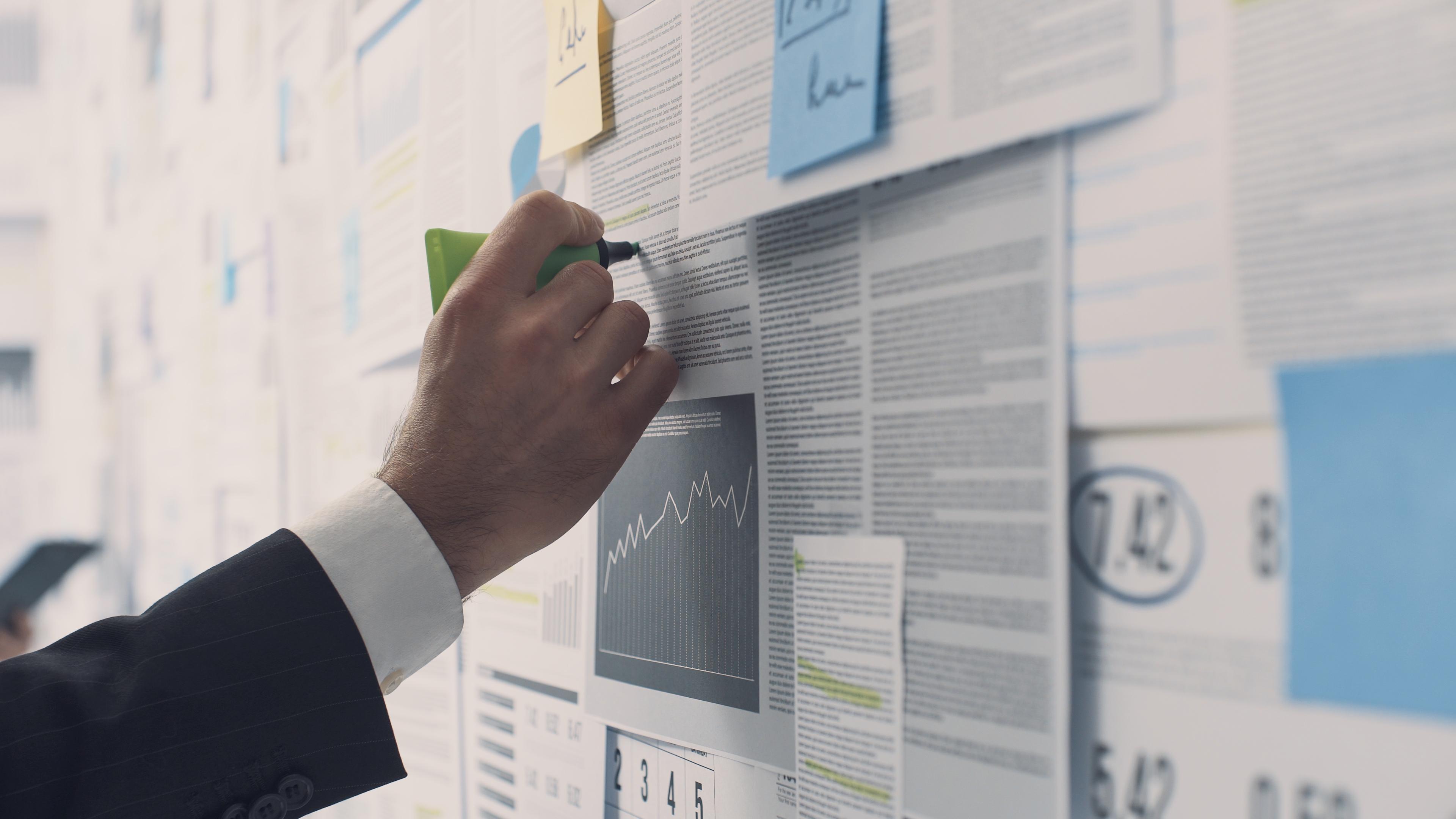 business man looking at charts and data